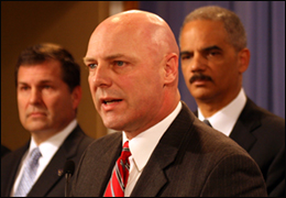 """FBI Executive Assistant Director Shawn Henry, with Attorney General Eric Holder (right) and Chief Postal Inspector Guy Cottrell, talks about """"Broken Trust."""""""