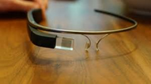 Google Glass Explorer Edition projects a computer screen and receives voice commands to record and connect.