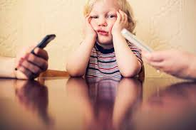 Two big reasons why parents need to limit their own screen time